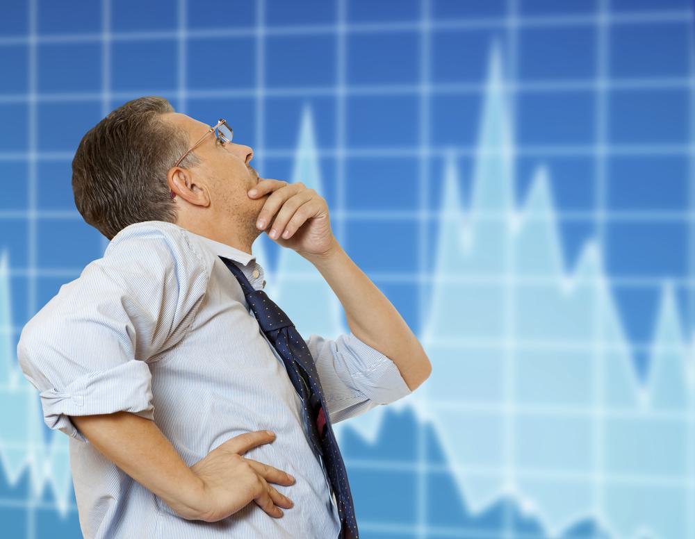 Stock-trader-looking-at-monitors